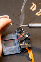 Soldering power leads onto shutter assembly motor on a Canon 550D / T2i.